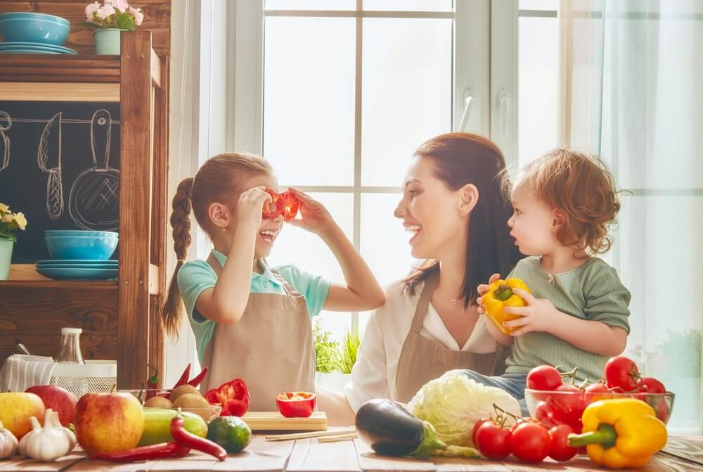 Parent teaching child about healthy snacks