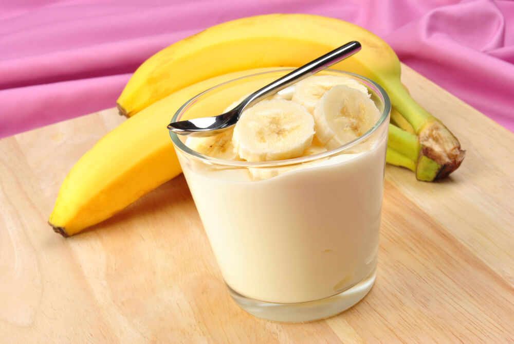 Toddlers Meals Yogurt with a Slice of Banana